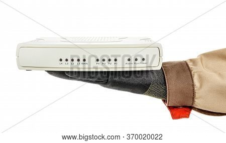 Voip Gateway Lies In Palm Of It-specialist Hand In Black Protective Glove And Brown Uniform Isolated