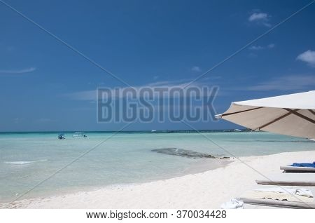 A Perfect Morning On The Beautiful White Sand Beach With A Chaise Lounge And Umbrella On The Shore O
