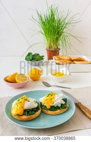 Eggs Florentine, English Muffins, Grilled Ham, Poached Eggs, Mornay Sauce, Chive Herbs, Lemon, Cup O
