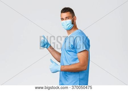 Healthcare Workers, Covid-19, Coronavirus And Preventing Virus Concept. Optimistic Cheerful Male Doc