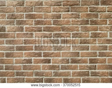Brick Wall Texture Background Material Industrial Construction. Wall Of Brown Embossed Decorative Br