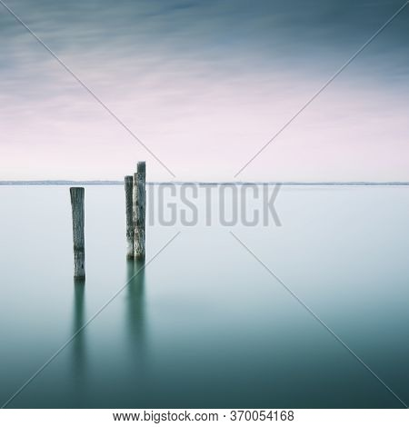 Wooden Poles In Lake Gardasee In Italy, Europe