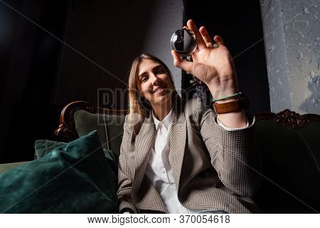 Woman In Business Suit Holding Crystal Ball