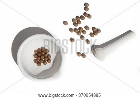 Tibetan Medicine Pills With Mortar On White Background