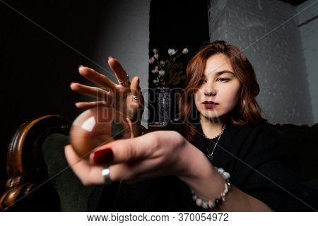 Woman In Black Suit Holding Crystal Ball