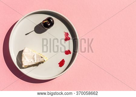 Cherry And One Slice Of Brie Cheese On The Plate On Rose Background. Copy Space. Top View