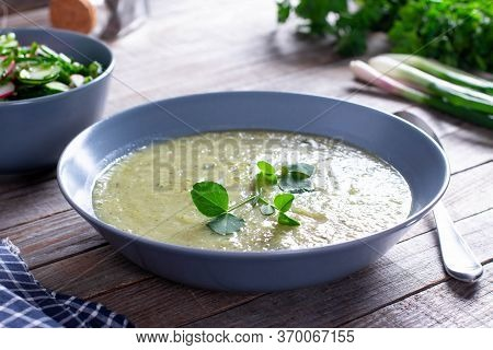 Bowl Of Broccoli And Green Peas Cream Soup On Wooden Table, Vegetable Soup
