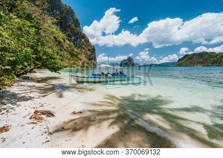 El Nido, Palawan, Philippines. Boat Moored At Tropical Solitude Secluded Beach