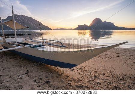 El Nido, Exotic Boat On Beach. Sunset Behind Beautiful Cadlao Island. Palawan Island, Philippines