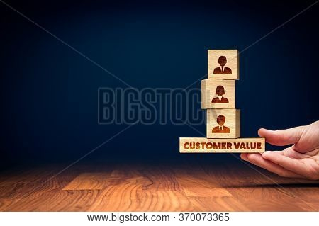 Customer Value Balance Concept. Hand Of Manager Balancing Cubes With Icons Of Customers, Bottom Piec