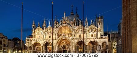 St Mark`s Basilica Or San Marco At Night, Venice, Italy. Medieval Basilica Is Top Landmark Of Venice