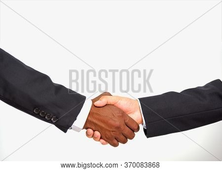 Close Up Of African Businessman Black People Partnership Handshake Between Together Caucasian White