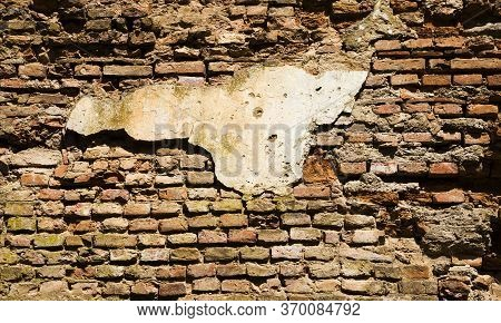 Old Clay Orange Bricks In Abandoned Ruined Red Brick Building, Fortress Ruins In Europe