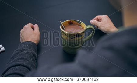 High Quality Close-up Of A Man Mixing Hot Chocolate Beverage In His Cup With Small White Marshmallow
