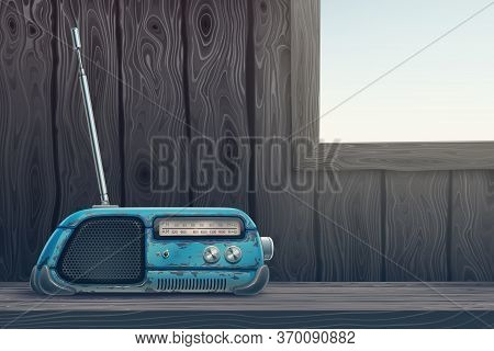 Old Retro Radio Receiver On A Wooden Table Background. Dark Room With Light Window Through Wood Wall