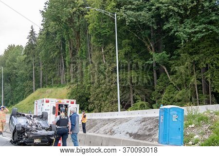 A Picture Of A Car That Flipped Over In An Accident On The Trans Canada Highway, North Bound.    Jun
