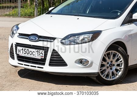 Novosibirsk/ Russia - May 03 2020: White Ford Focus, Compact Sedan Car Parked Outdoors On A Warm Sum