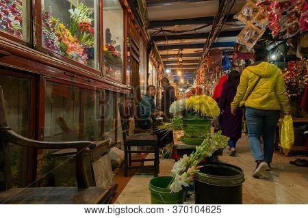 Kolkata, West Bengal, India - 29th December 2019 : Flowers Inside Showcase At Flower Market Of Espla