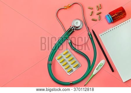 Concept, Of Medical Equipment, Flat Lay Top View. A Stethoscope On A Pink Background. Health Checkup