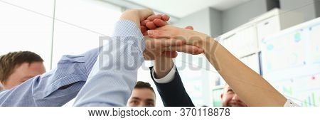 Togetherness Team Workers At Meeting In Office. Company Employees Gathered In Meeting Room. They Rea