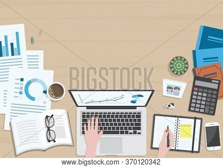 Wood Textured Desk From Top View With Hands Of Woman Working On Laptop Computer And Writing On Organ
