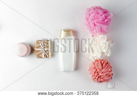Cosmetics And Self-care. The Composition Is Laid Out In A Row Of Washcloths, Creams, Shower Gels And