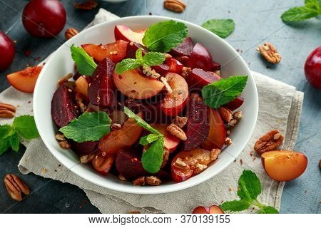 Vegan Plum, Beet Salad With Pecan Nuts, Mint And Herbs In White Bowl. Healthy Summer Food.