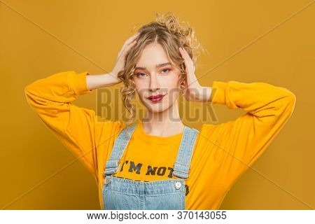 Pretty Girl With Updo Hairdo On Yellow Background