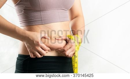 Fat Woman, Fat Belly, Chubby, Obese Woman Hand Holding Excessive Belly Fat With Measure Tape, Woman
