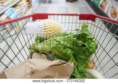 Fresh Vegetables And Fruits In A Shopping Trolly At Store.