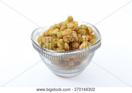 Raisins In Glass Bowl On White Background