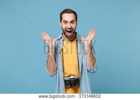 Traveler Tourist Man In Yellow Summer Casual Clothes With Photo Camera On Neck Isolated On Blue Back