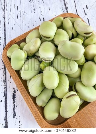 Closeup Raw Broad Bean Seeds On A Wooden Table