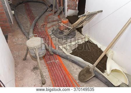 The Process Of Filling Floors In A New House. Concrete Floors In A New Building. Equipment For Filli
