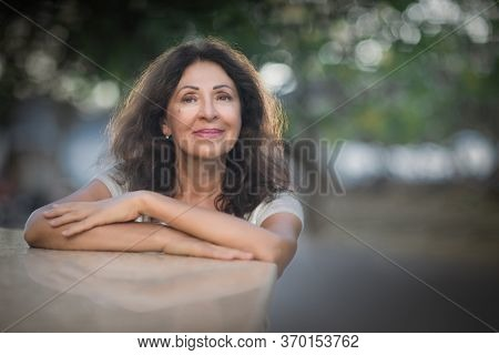 Outdoor portrait of a beautiful smiling senior woman