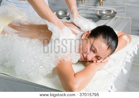 Young woman in hammam or turkish bath
