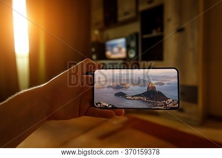 Concept Of Travel On A Smartphone. Stay At Home Tourism. Online Travel To Rio-de-janeiro. Sugarloaf