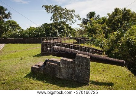 Ancient Fortress Wall Cannon Fort Zeelandia In The Subtropics Against A Background Of Green Trees An