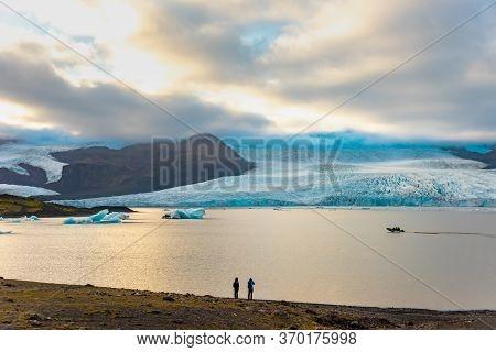 Glacier And Icebergs In Fjallsarlon Glacial Lagoon, Iceland. Great Tourist Attraction
