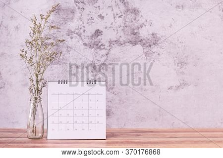 Calendar And Caspia Flower On Table Wooden. Day Celebration