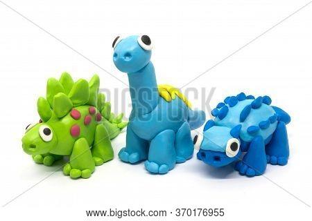 Play Dough Group Stegosaurus, Brachiosaurus, Ankylosaurus On White Background