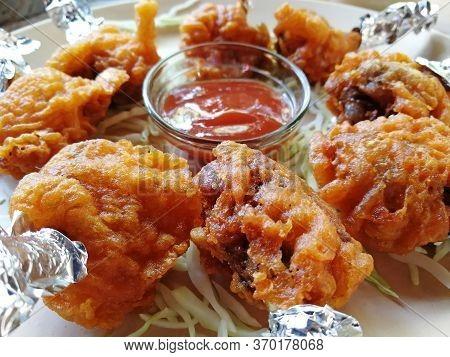 Chicken Lolipop, Chicken Winglet, Tandoori Chicken. Close Up, Side View.