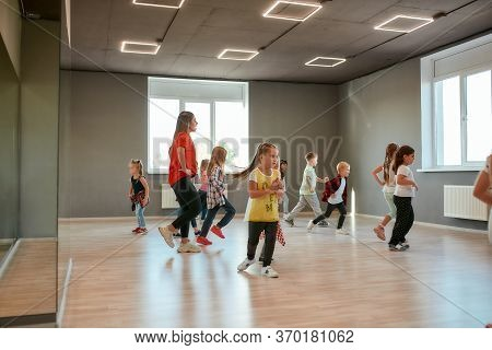 Group Of Little Boys And Girls Dancing While Having Choreography Class In The Dance Studio. Female D