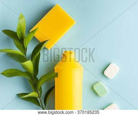 Liquid Dishwashing Liquid, Dishwasher Tablets On A Blue Background. Means For Washing Dishes. Copy S