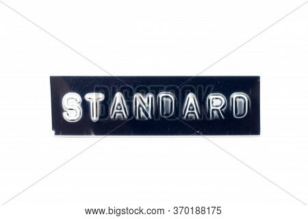 Embossed Letter In Word Standard In Black Banner On White Background