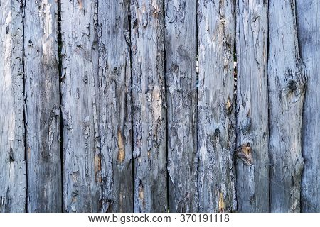 Part Of A Wooden Fence From Rough Boards Close-up
