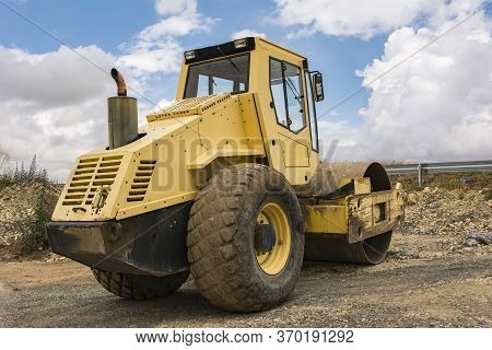 Yellow Steamroller Doing Road Construction Work In Spain