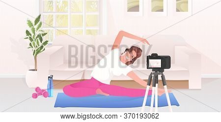 Woman Fitness Trainer Recording Video Blog Using Camera On Tripod Live Streaming Social Media Networ