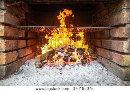 Heating The Grill, Huge Burning Flames Over The Grill, Fire Embers And Sparks, Burning Wood Coal