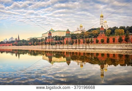 Walls And Towers Of The Moscow Kremlin With A Mirror Reflection In The Water Of The Moscow River Und